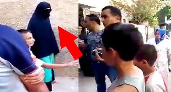 ضبط شخص متخفي في ملابس نسائية (شاهد الفيديو)