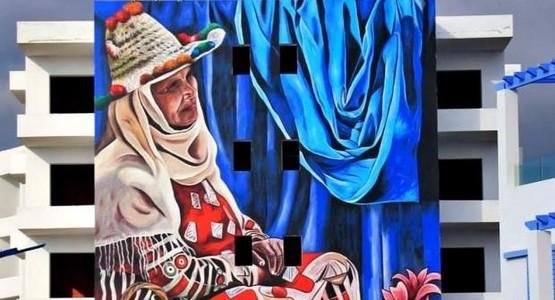 الفنان الرشندالي يبدع بجدارية سيدة جبلية  بكابو نيغرو